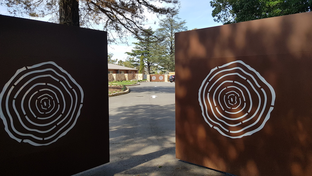 The secure gates leading to the exclusive Sequoia Lodge.